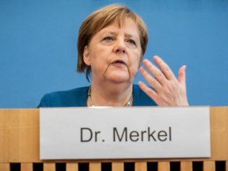 Angela Merkel sustine ca aceasta criza va mai dura