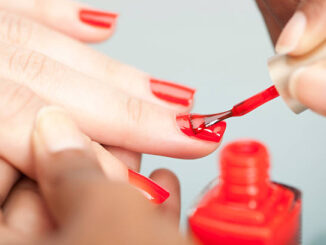 Woman getting manicure.
